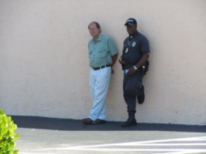 Joel Shumrak and the security guard always in the parking lot. Notice the Glock on his hip.